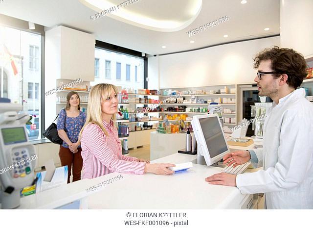 Pharmacist advising customers