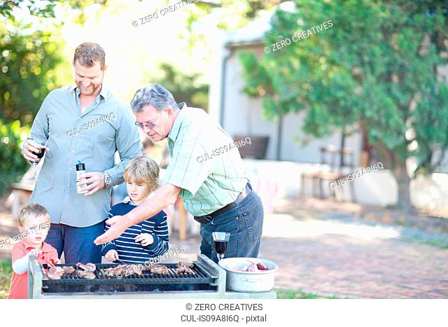 Male family members barbecuing