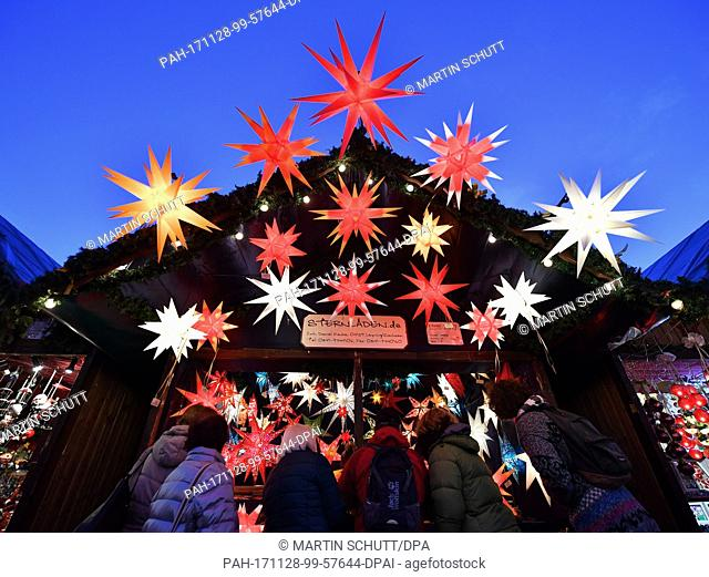 The christmasmarket opens in Erfurt, Germany, 28 November 2017. Some 200 stand owners offer sweets, food, spices and handcrafted pieces in front of the medieval...