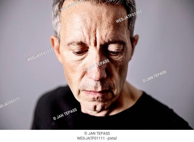 Portrait of pensive mature man