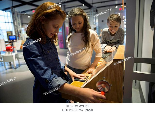 Curious girls at exhibit in science center