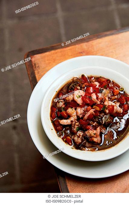 Overhead view of bowl with prawn and vegetable stew, Antigua, Guatemala
