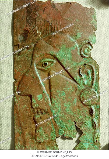 Face, possibly a portrait of a prominent warrior, embossed in copper