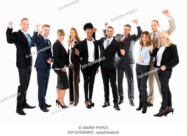 Full length portrait of happy business team celebrating success against white background