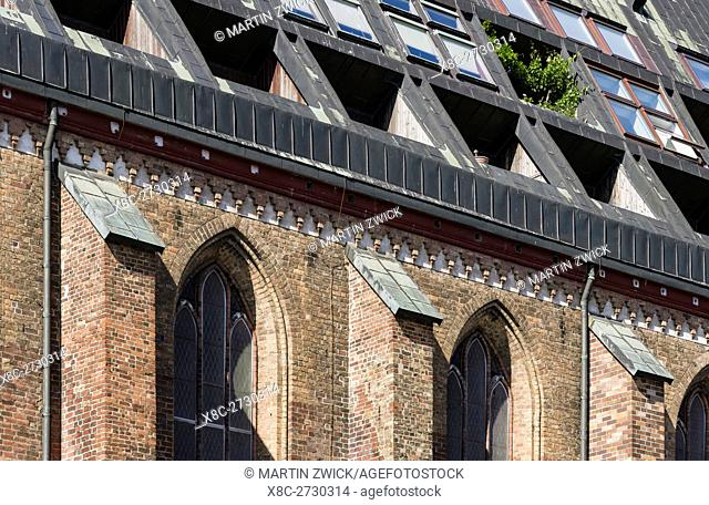 Church Nikolaikirche. The roof and attic is converted to offer appartements and guest rooms. The hanseatic city of Rostock at the coast of the german baltic sea