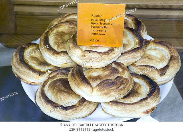 Typical pastries of Puglia in Italy with cheese tomato bechamel and puff pastry