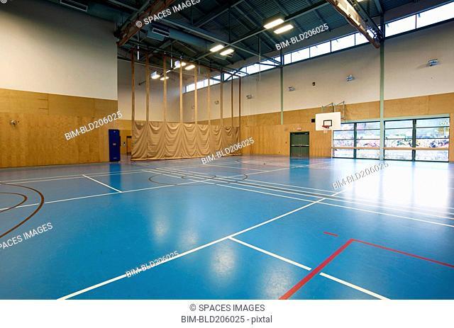 Empty indoor basketball court