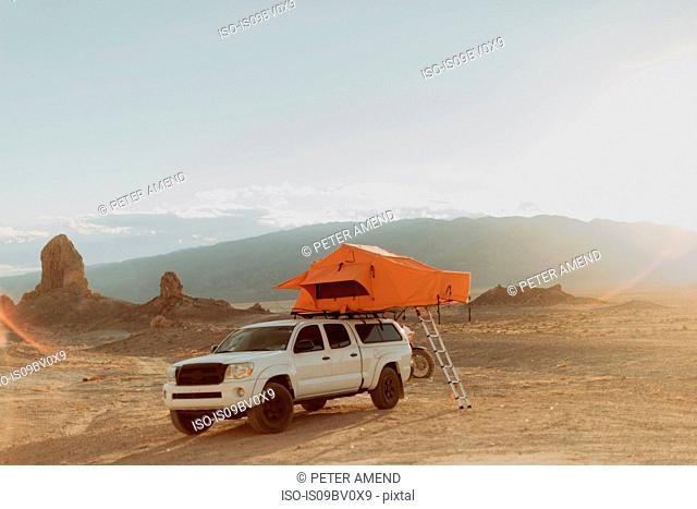 Off road vehicle with tent, Trona Pinnacles, California, US