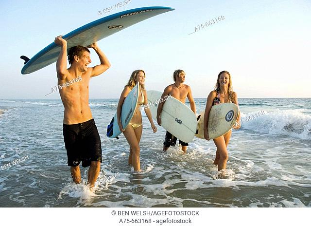 group of young surfers