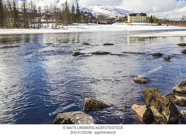 View from Wassara river on Mount Dundret in background, ice on the river and snow on the mountain at spring season, Gällivare, Swedish Lapland, Sweden