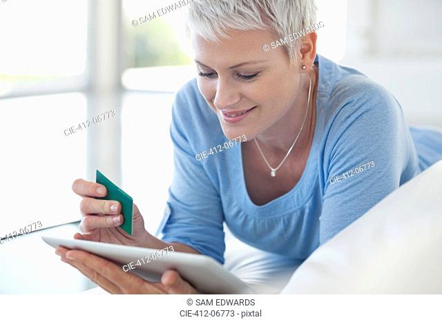 Woman shopping online with tablet computer