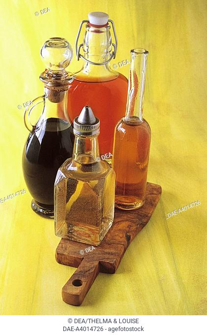Food. Still life - Red and white wine vinegar, balsamic vinegar and cider vinegar