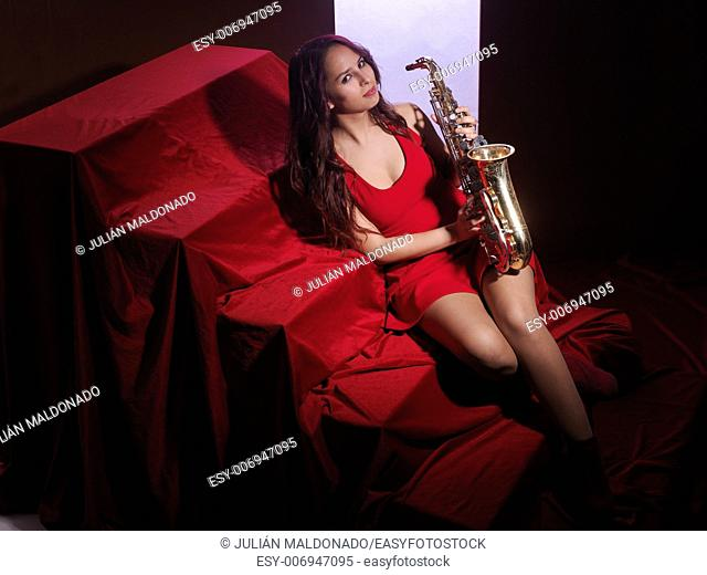 Sexy young woman with saxophone