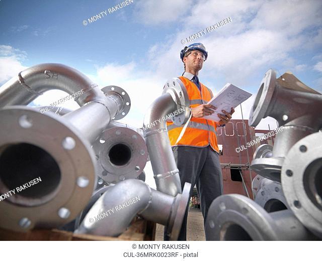 Businessman on shipbuilding site