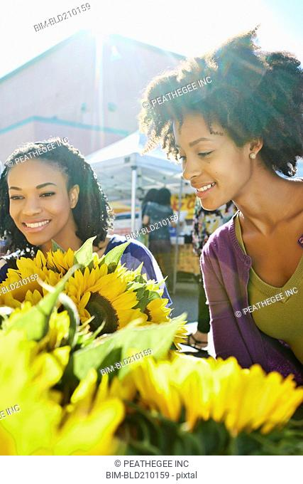 Women shopping together at flower stand