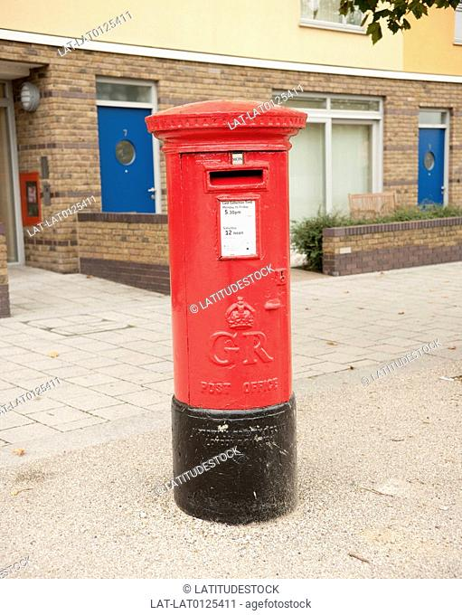 There are postboxes,red Royal Mail post boxes showing the relatively uncommon GR George Regina cipher,dated between 1910-1936,located at the Millennium Village