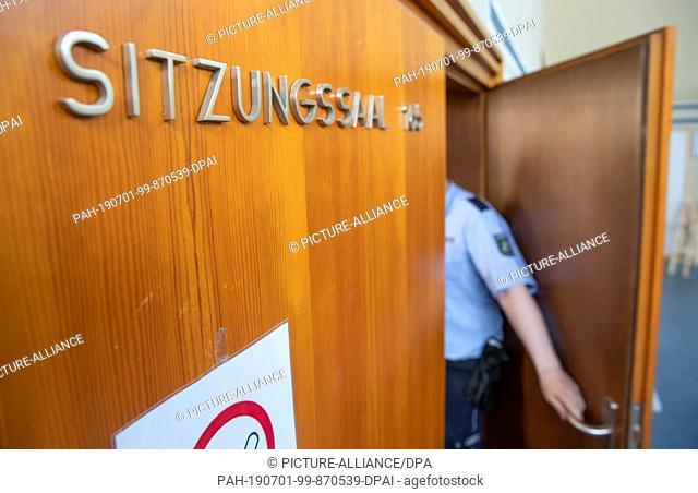 28 June 2019, North Rhine-Westphalia, Detmold: The defendants Heiko V., Mario S. and Andreas V. are sitting in the defendant's bench in the hall of the regional...