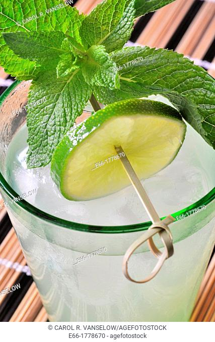 cocktail with lime slice and mint leaves, mojito