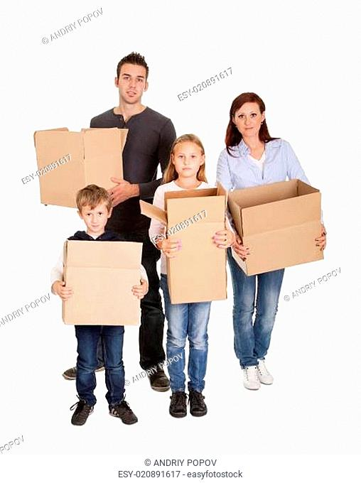 Happy young family carrying boxes