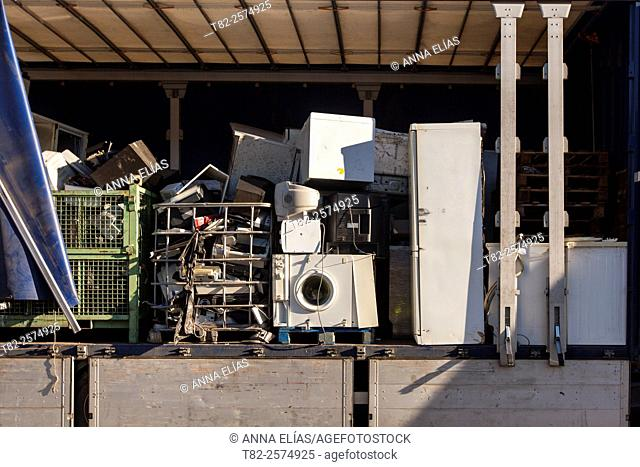 warehouse full of appliances and other items for recycling