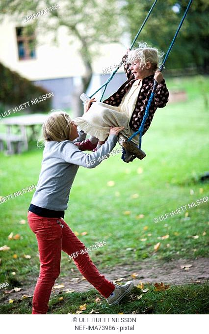 Scandinavian girls by a swing, Sweden