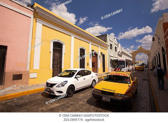 Traffic scene near the Arch and Quarter of Dragon, Merida, Riviera Maya, Yucatan Province, Mexico, Central America