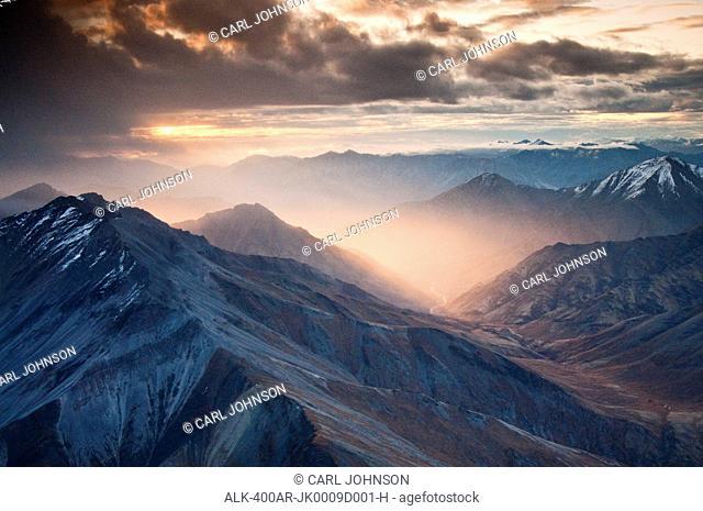 Aerial view of morning light shining through a rain storm in the Brooks Range, Gates of the Arctic National Park & Preserve, Arctic Alaska, Fall