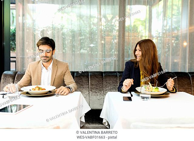 Smiling woman looking at man in a restaurant