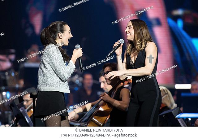 Pianist Emily Bear (L) and British singer Melanie Chisholm performing on stage during the 'Night Of The Proms' at the Barclaycard Arena in Hamburg, Germany
