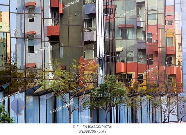 Mirror windows reflecting a colorful modern residential building in Little Italy section of San Diego, California, USA