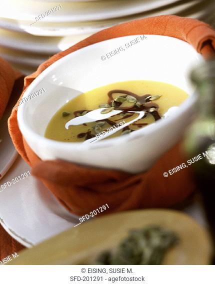Pumpkin soup with pumpkin seeds, pumpkin seed oil & cream