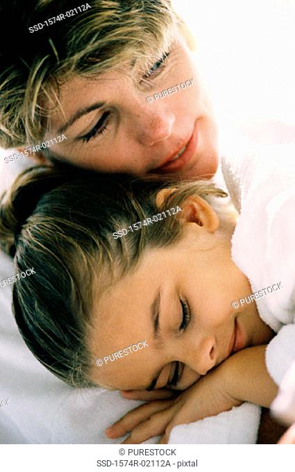 Close-up of a mother sleeping with her daughter