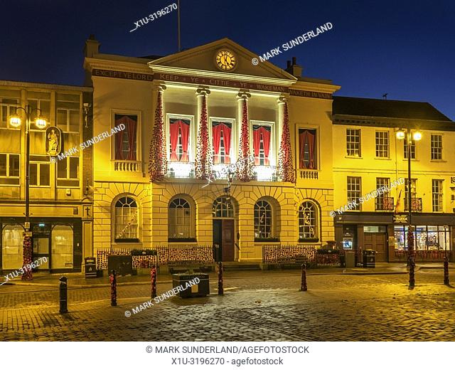 Ripon Town Hall floodlit ast dusk in the Market Place at Ripon North Yorkshire England
