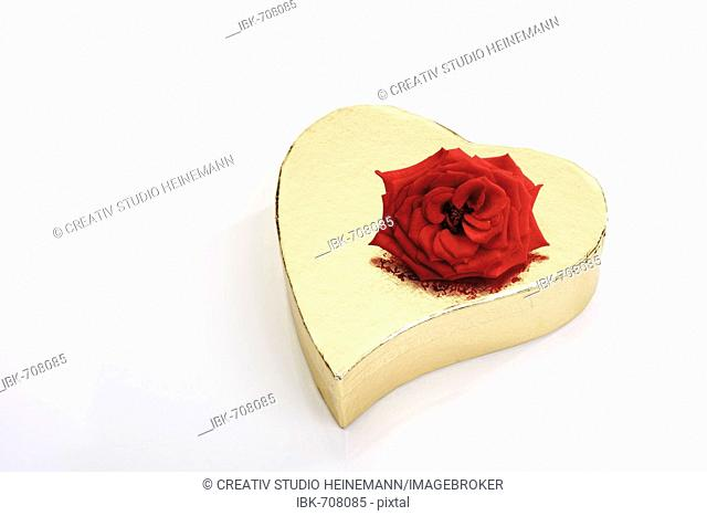 Golden heart-shaped gift box with a red rose
