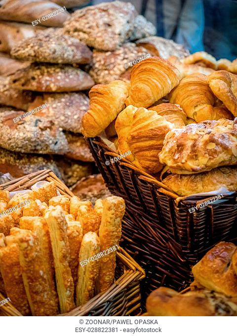 Close up of freshly baked buns, croissants and breadsticks