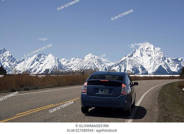 Car on a road, Grand Teton National Park, Wyoming, USA
