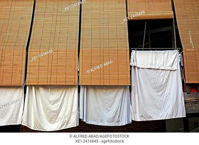 Blinds, hanging clothes, district of Barceloneta, Barcelona Catalonia, Spain