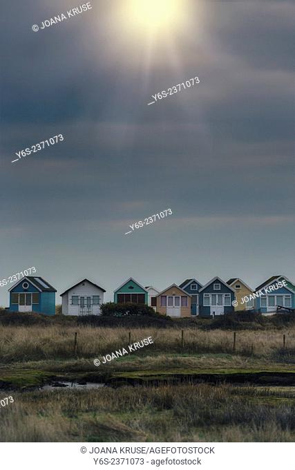 beach huts in the late evening sun