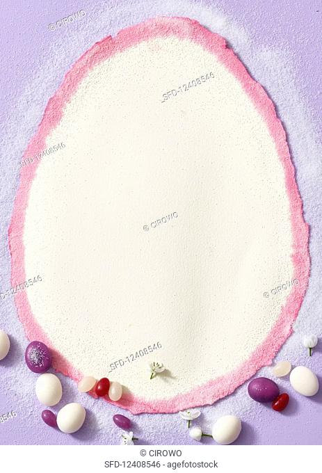 A white, egg-shaped background with sugared eggs
