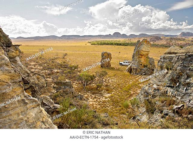 View of a Land Rover parked on the plains of Isalo National Park in southern Madagascar. This region of the park is on the Malaso circuit