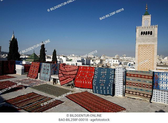 The minaret of the mosque Zaytouna or big mosque in the Old Town or Medina of the capital of Tunis in the Norder of Tunisia in North Africa at the Mediterranean...