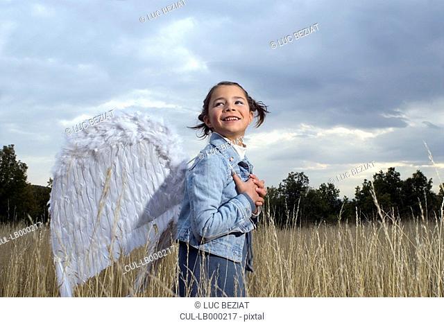 Girl wearing angel wings