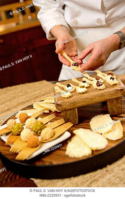 parmigiano reggiano truffles, parmesa cheese spoons, and parmesan cheese rind puffs display