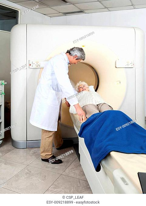 Doctor Preparing Woman For CT Scan Test
