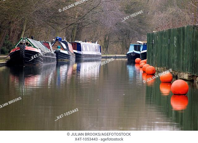 Narrowboats moored on the Oxford canal at the Oxford canal terminus into the Thames at Isis lock