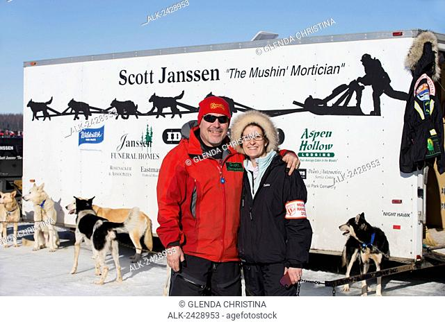 Scott Janssen, the Mushin' Mortician, #20 poses with his wife Debbie just before mushing in the 2014 Iditarod trail, Willow, Alaska