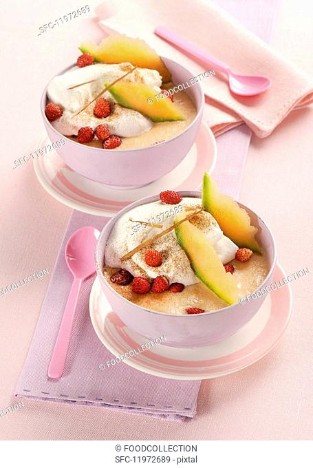 Melon sorbet with cream and strawberries