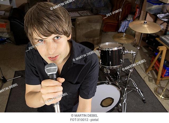 Singer of band practicing in studio