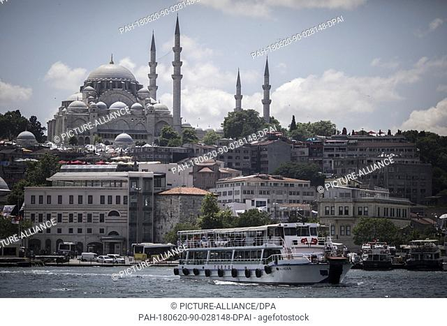 A ferry is backdropped by the The Süleymaniye Mosque in Istanbul, Turkey, 20 June 2018. The country will hold snap elections on June 24th