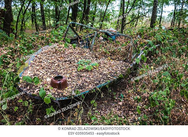 Old motorboat in area of Yacht club in Pripyat ghost city of Chernobyl Nuclear Power Plant Zone of Alienation in Ukraine